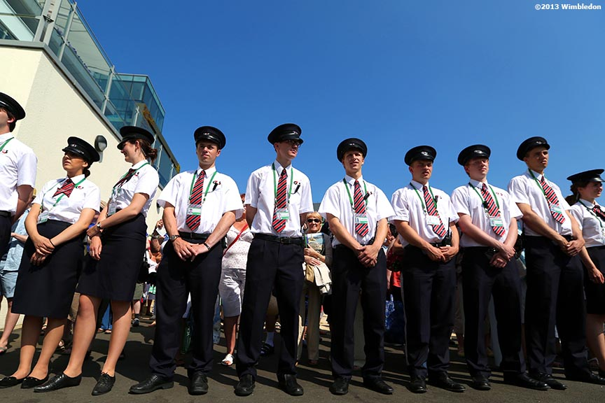 """Guards prepare to open the gates at the All England Lawn and Tennis Club in London, England Sunday, July 6, 2013 during the 2013 Championships Wimbledon."""