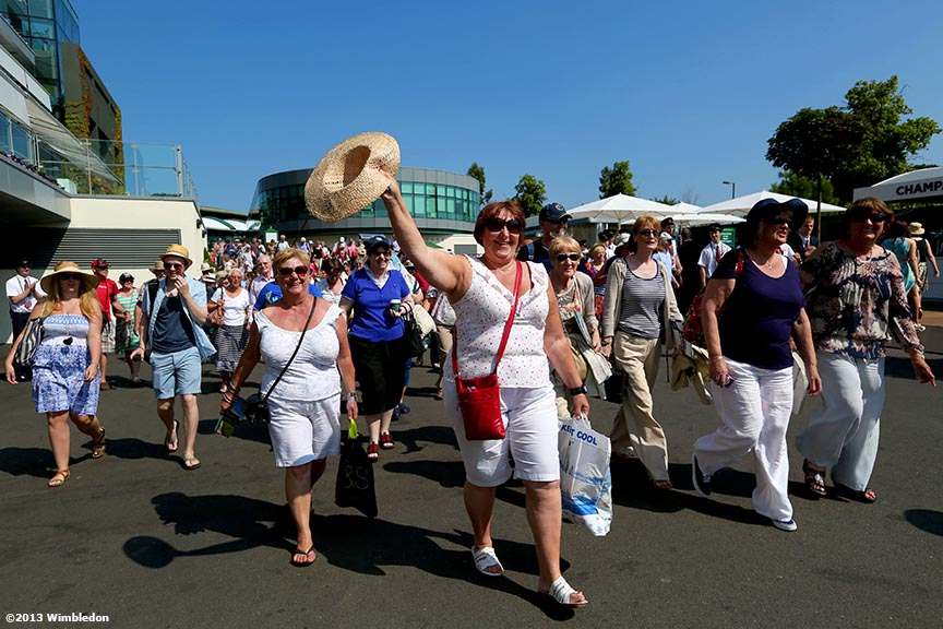 """Fans enter the grounds at the All England Lawn and Tennis Club in London, England Sunday, July 6, 2013 during the 2013 Championships Wimbledon."""
