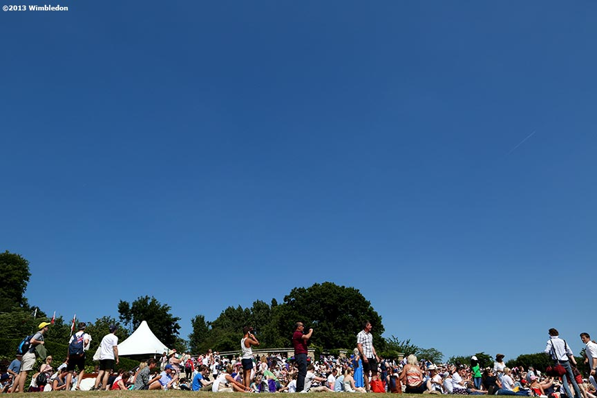 """Fans gather on Henman Hill at the All England Lawn and Tennis Club in London, England Sunday, July 6, 2013 during the 2013 Championships Wimbledon."""