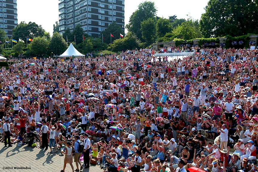 """Fans camped on Henman Hill at the All England Lawn and Tennis Club in London, England react as they watch Andy Murray of Scotland play in the Gentlemen's Singles Final at the 2013 Championships Wimbledon Saturday, July 6, 2013."""
