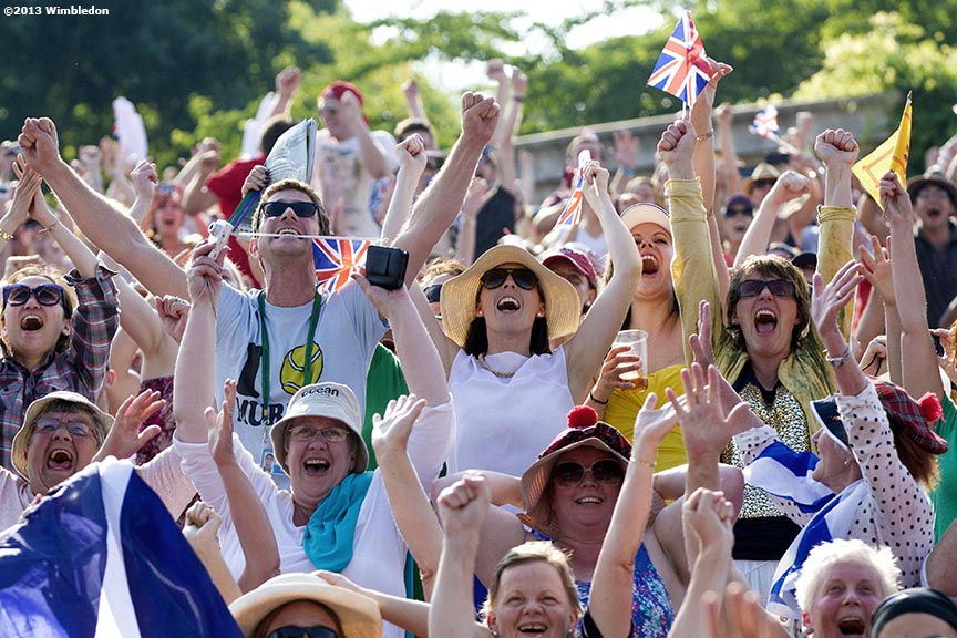 """Fans camped on Henman Hill at the All England Lawn and Tennis Club in London, England react as they watch Andy Murray of Scotland take Championship Point to win the 2013 Championships Wimbledon Saturday, July 6, 2013."""