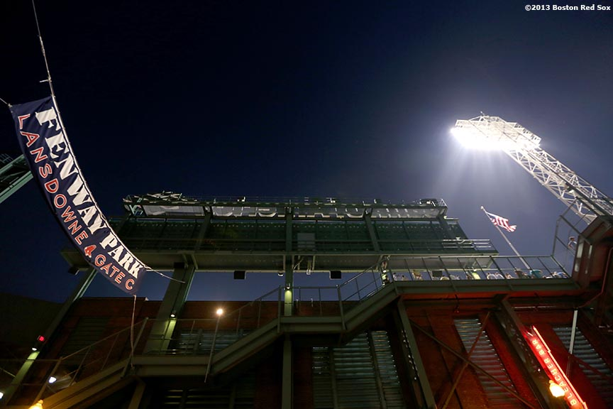 """A banner hanging over Lansdowne Street is shown during a game between the Boston Red Sox and the New York Yankees Friday, July 19, 2013 at Fenway Park in Boston, Massachusetts."""