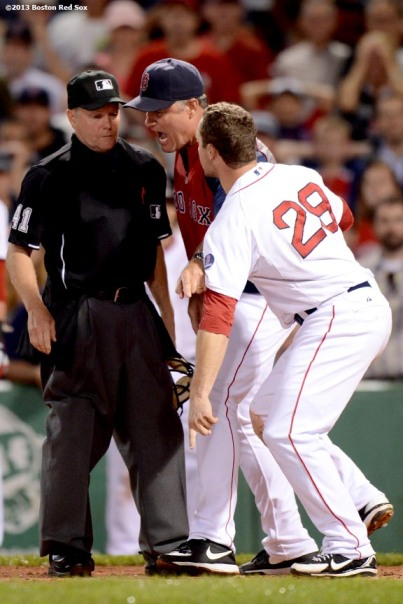 """Boston Red Sox manager John Farrell and outfielder Daniel Nava argue with home plate umpire Jerry Meals after Nava was called out while attempting to score on a sacrifice fly during the eighth inning of a game against the Tampa Bay Rays Monday, July 29, 2013 at Fenway Park in Boston, Massachusetts. Farrell was ejected for arguing the call."""