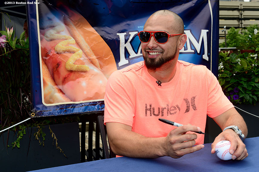 """Boston Red Sox outfielder Shane Victorino smiles during a National Hot Dog Day tasting contest sponsored by Kayem Franks at the Landing at Long Wharf in Boston, Massachusetts Tuesday, July 23, 2013."""