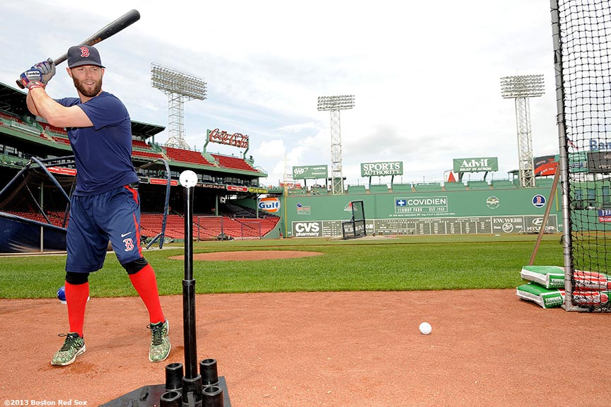 """Boston Red Sox second baseman Dustin Pedroia gives a hitting clinic sponsored by Franklin Sports Equipment Fenway Park in Boston, Massachusetts before a press conference Wednesday, July 24, 2013 announcing an eight-year contract extension continuing through the 2021 season."""