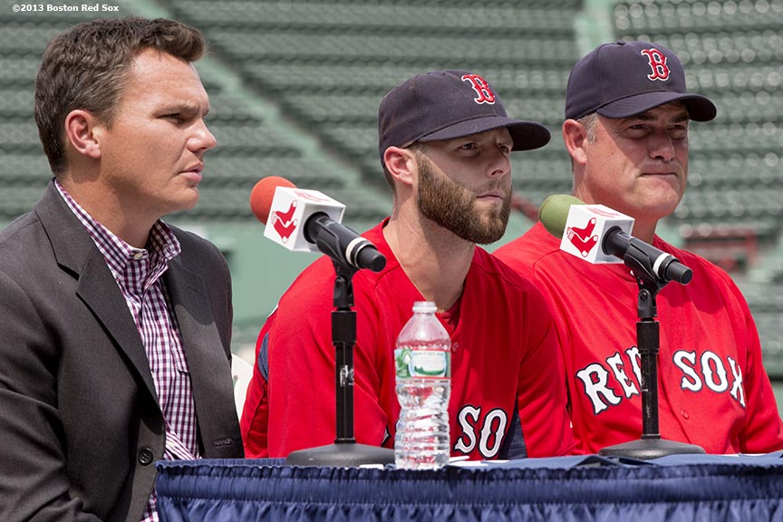 """Boston Red Sox second baseman Dustin Pedroia addresses the media at Fenway Park in Boston, Massachusetts during a press conference Wednesday, July 24, 2013 announcing an eight-year contract extension continuing through the 2021 season. Executive Vice President/General Manager Ben Cherington (left) made the announcement."""