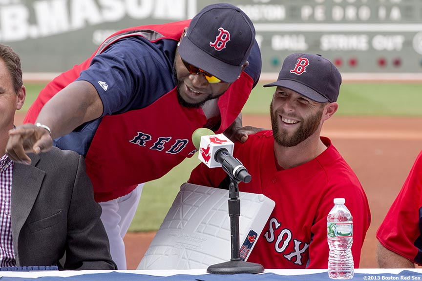 """Boston Red Sox second baseman Dustin Pedroia jokes with designated hitter David Ortiz at Fenway Park in Boston, Massachusetts during a press conference Wednesday, July 24, 2013 announcing Pedroia's eight-year contract extension continuing through the 2021 season."""