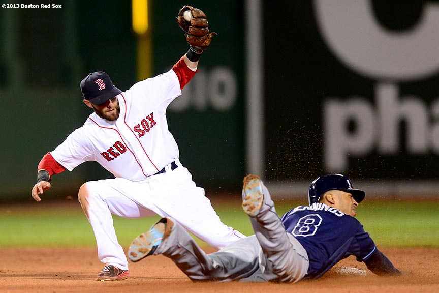"""Boston Red Sox second baseman Dustin Pedroia applies a tag on center fielder Desmond Jennings during the seventh inning of a game against the Tampa Bay Rays Thursday, July 24, 2013 at Fenway Park in Boston, Massachusetts."""