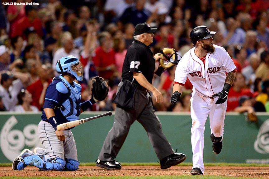 """Boston Red Sox first baseman Mike Napoli hits a solo home run during the seventh inning of a game against the Tampa Bay Rays Thursday, July 24, 2013 at Fenway Park in Boston, Massachusetts."""