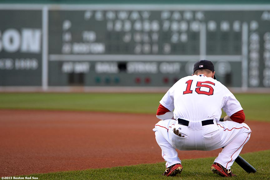 """Boston Red Sox second baseman Dustin Pedroia warms up at Fenway Park in Boston, Massachusetts Wednesday, July 4, 2013 during his first game after signing an eight-year contract extension continuing through the 2021 season."""