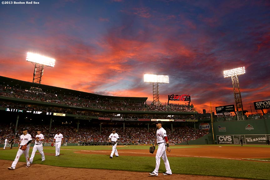 """The sun sets over Fenway Park during a game between the Boston Red Sox and the Tampa Bay Rays Thursday, July 24, 2013."""