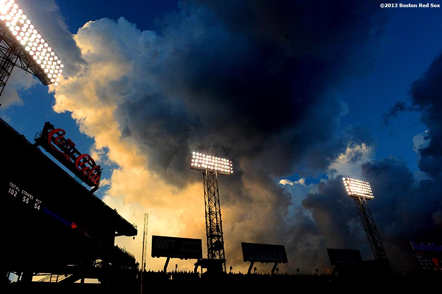 """Clouds form over the Green Monster at Fenway Park in Boston, Massachusetts during a game between the Boston Red Sox and the Tampa Bay Rays Monday, July 29, 2013."""