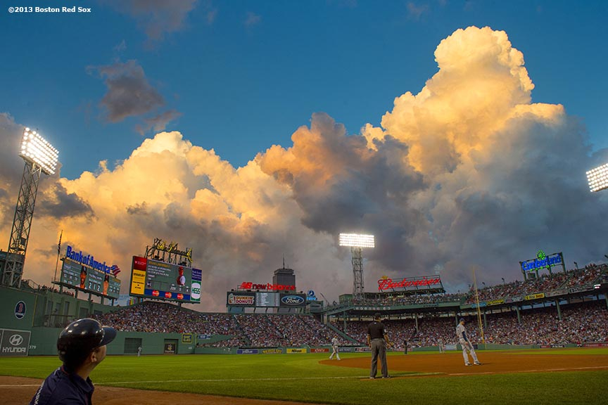 """Clouds form over Fenway Park in Boston, Massachusetts during a game between the Boston Red Sox and the Tampa Bay Rays Monday, July 29, 2013."""