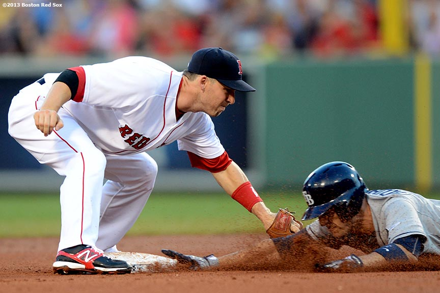 """Boston Red Sox shortstop Stephen Drew applies a tag at second base on left fielder Sean Rodriguez during the fourth inning of a game against the Tampa Bay Rays Monday, July 29, 2013 at Fenway Park in Boston, Massachusetts."""