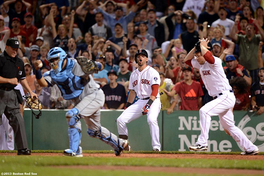 """Boston Red Sox outfielder Daniel Nava (right) and center fielder Jacoby Ellsbury (center) react after Nava is tagged out at home plate by catcher Jose Molina after attempting to score on a sacrifice fly during the eighth inning of a game against the Tampa Bay Rays Monday, July 29, 2013 at Fenway Park in Boston, Massachusetts."""