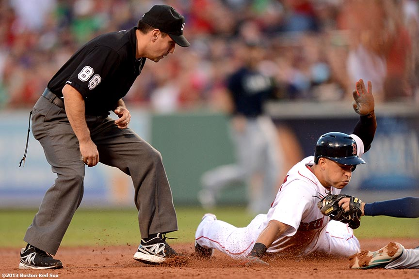"""Boston Red Sox infielder Jose Iglesias dives towards second base during the second inning of a game against the Seattle Mariners Tuesday, July 30, 2013 at Fenway Park in Boston, Massachusetts."""