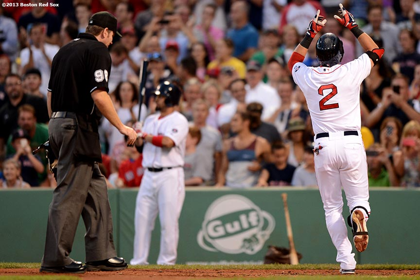 """Boston Red Sox icenter fielder Jacoby Ellsbury celebrates after hitting a solo home run during the second inning of a game against the Seattle Mariners Tuesday, July 30, 2013 at Fenway Park in Boston, Massachusetts."""