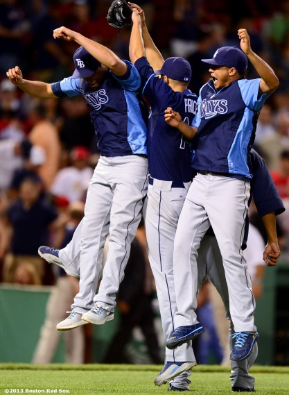 """Tampa Bay Rays starting pitcher David Price celebrates with teammates after throwing a complete game two-hitter against the Boston Red Sox Thursday, July 24, 2013 at Fenway Park in Boston, Massachusetts."""