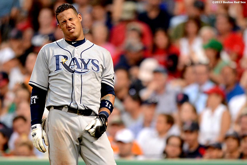 """""""Tampa Bay Rays shortstop Yunel Escobar reacts after getting hit by a pitch during the fifth inning of a game against the Boston Red Sox Monday, July 29, 2013 at Fenway Park in Boston, Massachusetts."""""""