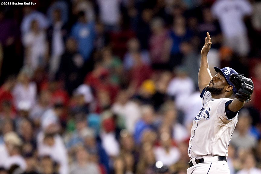 """Tampa Bay Rays closer Fernando Rodney reacts after recording a save during the ninth inning of a game against the Boston Red Sox Monday, July 29, 2013 at Fenway Park in Boston, Massachusetts."""