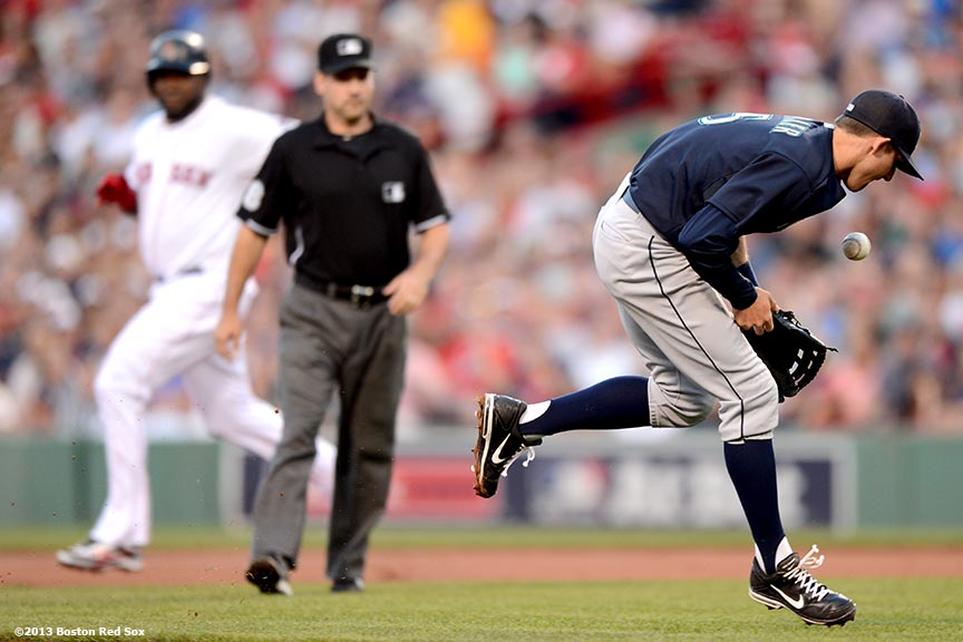 """Seattle Mariners shortstop Brad Miller makes an error while fielding a ground ball during the second inning of a game against the Boston Red SoxTuesday, July 30, 2013 at Fenway Park in Boston, Massachusetts."""