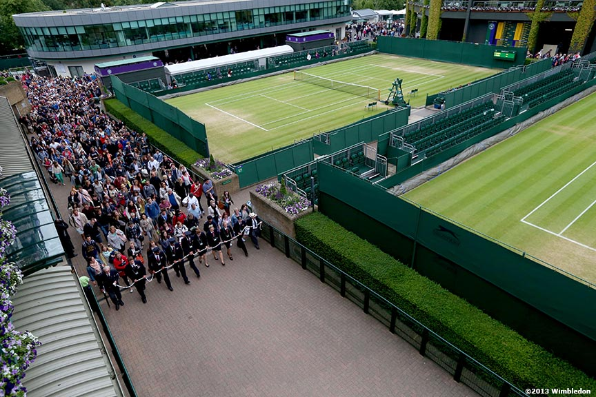 """Stewards lead fans into the grounds at the All England Lawn and Tennis Club in London, England Tuesday, July 2, 2013 during the 2013 Championships Wimbledon."""