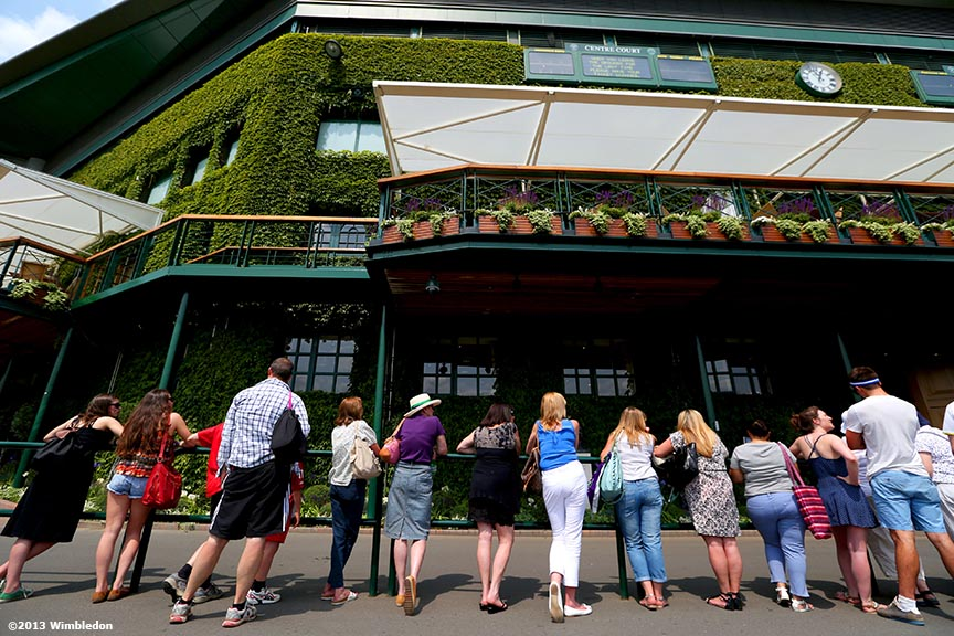 """Fans await player arrival outside Centre Court at the All England Lawn and Tennis Club in London, England Friday, July 5, 2013 during the 2013 Championships Wimbledon."""