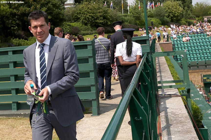 """Former tennis player Tim Henman walks toward a broadcast booth at the All England Lawn and Tennis Club in London, England Friday, July 5, 2013 during the 2013 Championships Wimbledon."""
