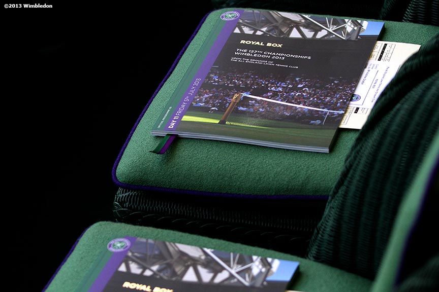 """Programs in the Royal Box on Centre Court are shown at the All England Lawn and Tennis Club in London, England Friday, July 5, 2013 during the 2013 Championships Wimbledon."""