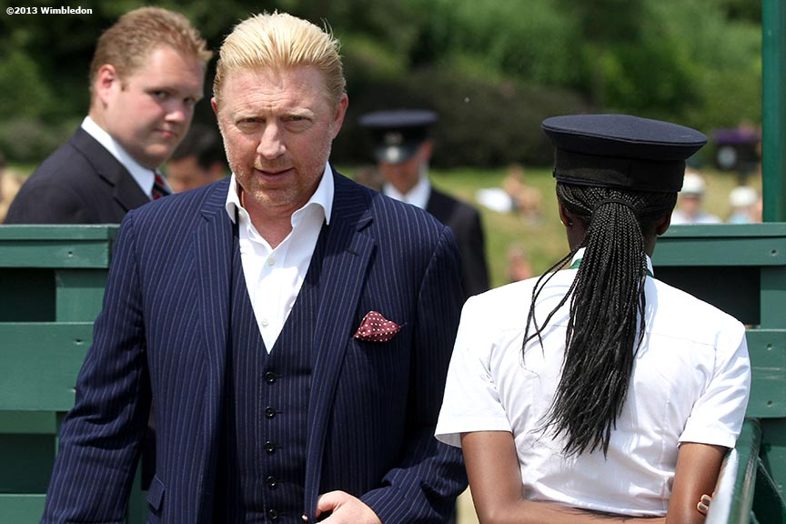 """Former tennis player Boris Becker walks toward a broadcast booth at the All England Lawn and Tennis Club in London, England Friday, July 5, 2013 during the 2013 Championships Wimbledon."""