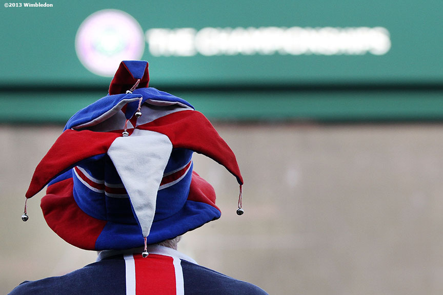 """""""A fan watches the big screen outside No. 1 Court at the All England Lawn and Tennis Club in London, England Tuesday, July 2, 2013 during the 2013 Championships Wimbledon."""""""