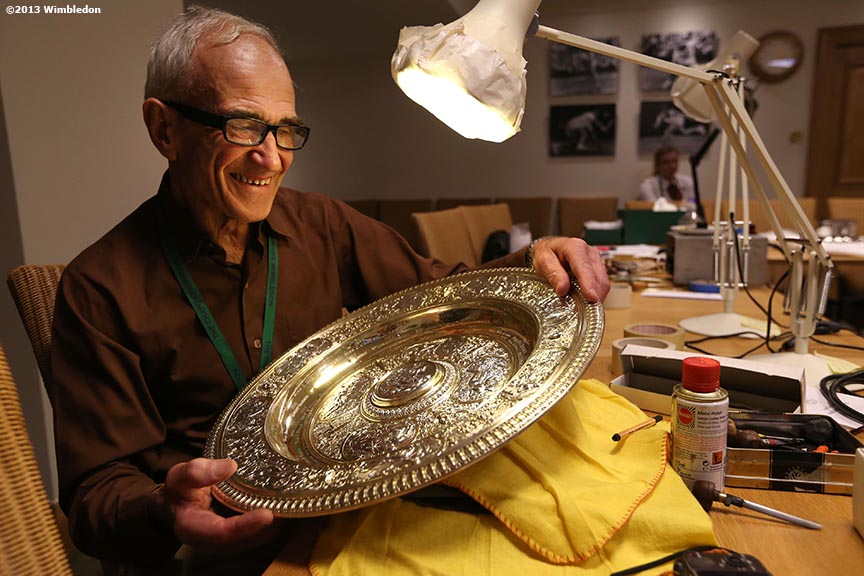 """Roman Zoltawski, official All England Club trophy engraver, holds the Venus-Rosewater Dish before the Ladies' Championship Match on Centre Court at the All England Lawn and Tennis Club in London, England Saturday, July 6, 2013 during the 2013 Championships Wimbledon."""
