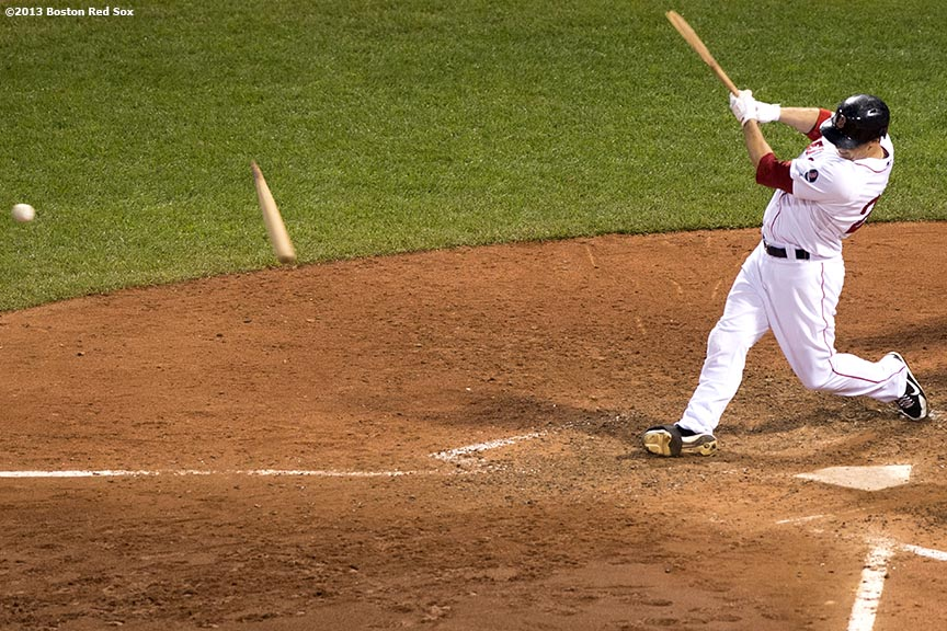 """Boston Red Sox outfielder Daniel Nava breaks his bat during the tenth inning of a game against the Seattle Mariners Wednesday, July 31, 2013 at Fenway Park in Boston, Massachusetts."""