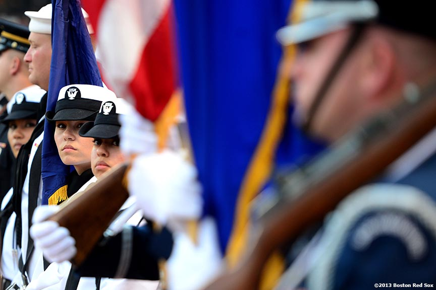 """The color guard awaits a Military appreciation ceremony before a game between the Boston Red Sox and the Seattle Mariners Wednesday, July 31, 2013 at Fenway Park in Boston, Massachusetts."""