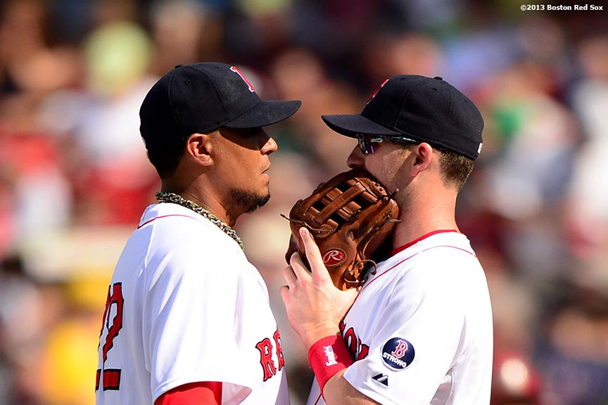 """Boston Red Sox pitcher Felix Doubront and shortstop Stephen Drew chat during the seventh inning of a game against the Arizona Diamondbacks Sunday, August 4, 2013 at Fenway Park in Boston, Massachusetts."""