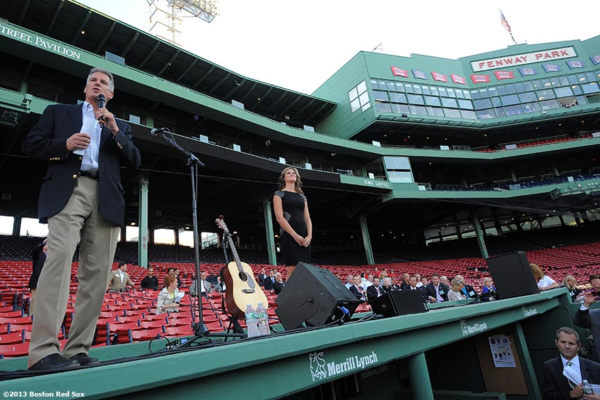 """""""Former Massachusetts Senator Scott Brown speaks on top of the Boston Red Sox dugout at Fenway Park in Boston, Massachusetts Thursday, August 15, 2013 during the Republican National Committee 'Making It Happen' Summer Meeting."""""""