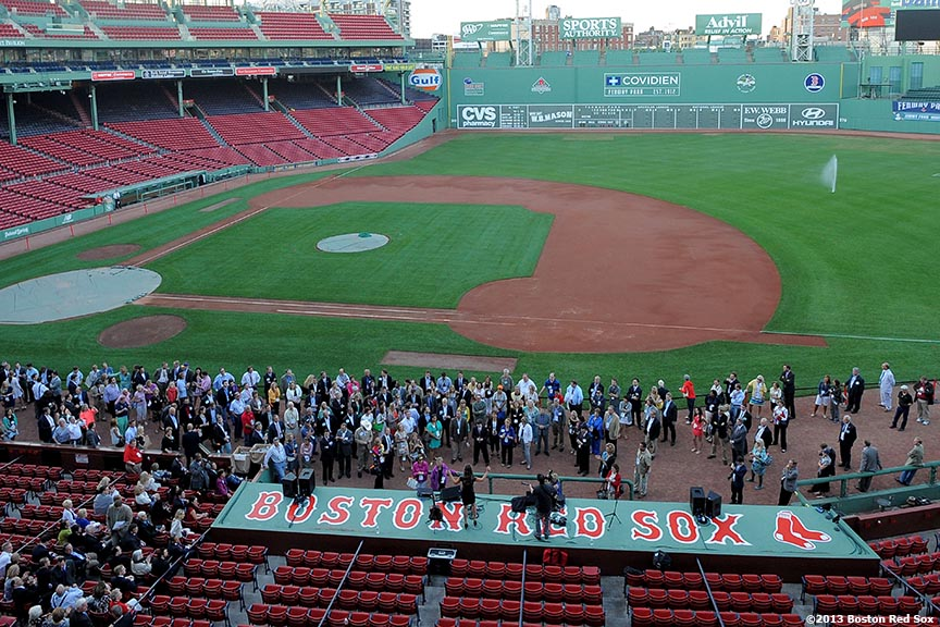 """""""Republican supporters gather in front of the Boston Red Sox dugout at Fenway Park in Boston, Massachusetts Thursday, August 15, 2013 for an appearance by Former Massachusetts Senator Scott Brown and a performance by his daughter, Ayla, during the Republican National Committee 'Making It Happen' Summer Meeting."""""""