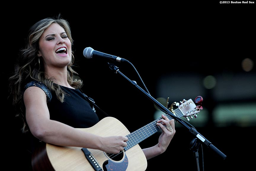 """""""Ayla Brown, country singer and daughter of former Massachusetts Senator Scott Brown, performs on top of the Boston Red Sox dugout at Fenway Park in Boston, Massachusetts Thursday, August 15, 2013 during the Republican National Committee 'Making It Happen' Summer Meeting."""""""