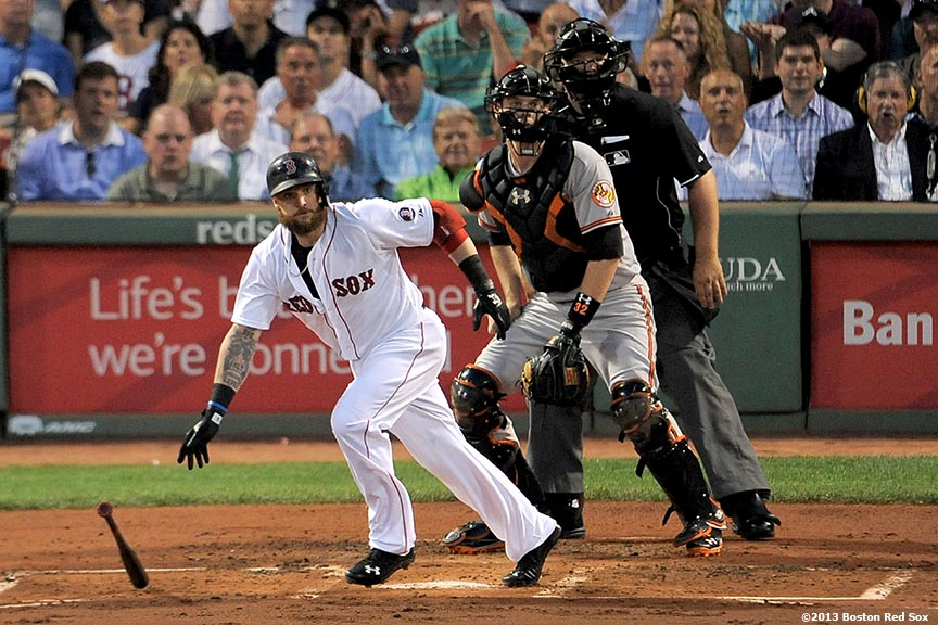 """Boston Red Sox outfielder Jonny Gomes hits a double during the second inning of a game against the Baltimore Orioles """