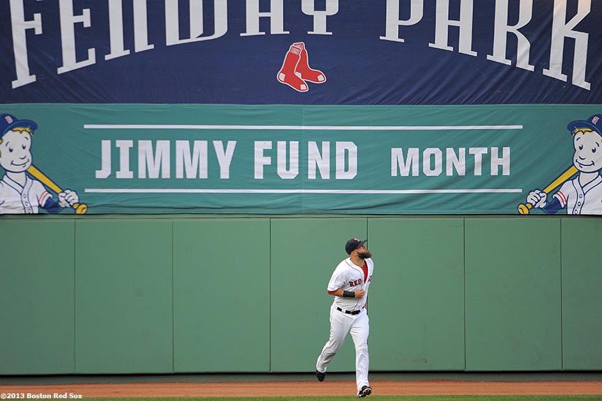 """Boston Red Sox first baseman Mike Napoli runs beneath a Jimmy Fund Month sign Tuesday, August 27, 2013 at Fenway Park in Boston, Massachusetts."""
