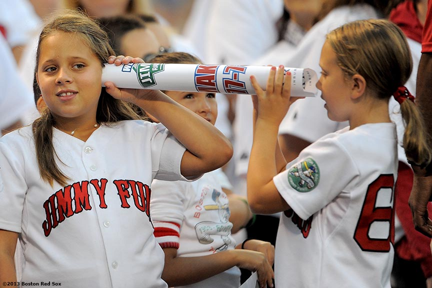 """Members of the Jimmy Fund chorus play before singing the National Anthem Tuesday, August 27, 2013 at Fenway Park in Boston, Massachusetts."""