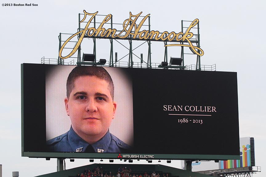 """A photograph of Sean Collier, an MIT Police Officer who was killed during the Boston Marathon attacks, is displayed on the video board Wednesday, August 28, 2013 at Fenway Park in Boston, Massachusetts. Members of Collier's family were in attendance to throw out the ceremonial first pitch."""