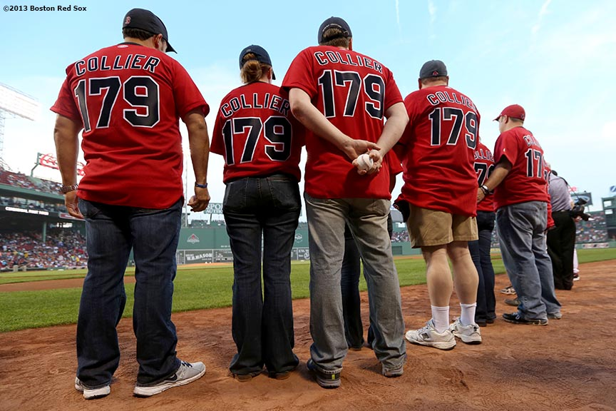 """Relatives of Sean Collier, an MIT Police Officer who was killed during the Boston Marathon attacks, stand on the field before throwing out the ceremonial first pitch Wednesday, August 28, 2013 at Fenway Park in Boston, Massachusetts."""