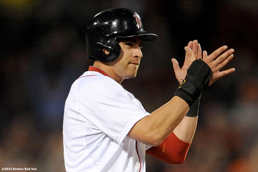 """Boston Red Sox center fielder Jacoby Ellsbury claps after stealing second base during the eighth inning of a game against the Baltimore Orioles Thursday, August 29, 2013 at Fenway Park in Boston, Massachusetts."""