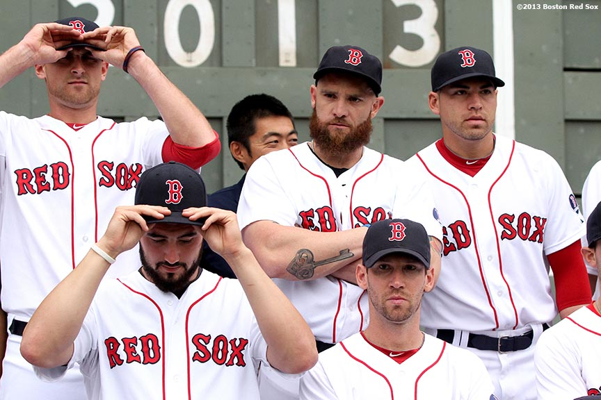 """Members of the Boston Red Sox adjust their caps before posing for the official team photograph Thursday, August 29, 2013 at Fenway Park in Boston, Massachusetts."""
