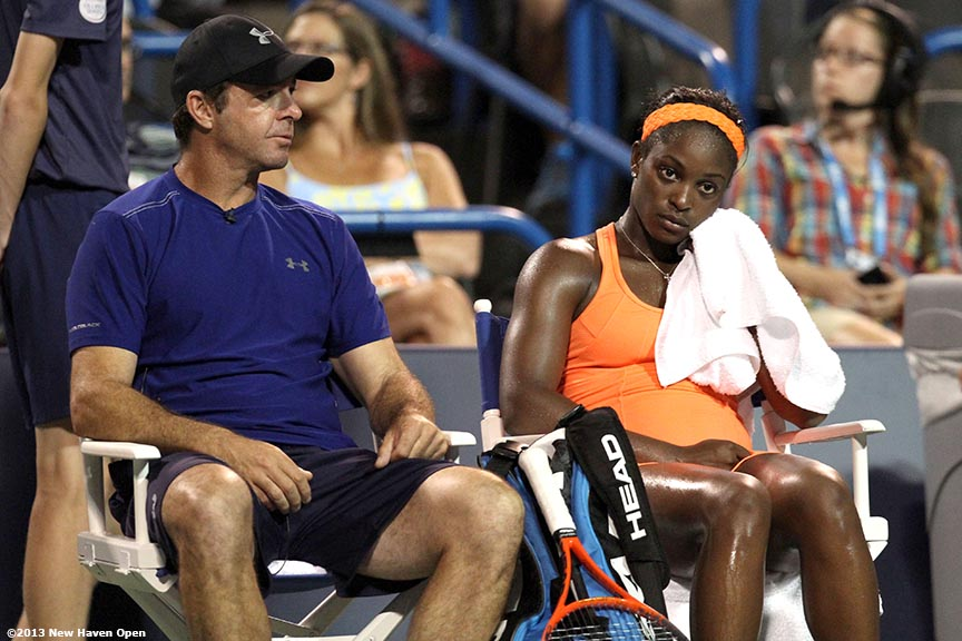 """Sloane Stephens reacts on a changeover during a match against Caroline Wozniacki as her coach, David Nainkin, looks on on Day 7 of the New Haven Open at Yale University in New Haven, Connecticut Thursday, August 20, 2013."""