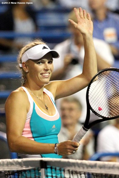 """Caroline Wozniacki waves to the crowd on Stadium Court after defeating Sloane Stephens on Day 7 of the New Haven Open at Yale University in New Haven, Connecticut Thursday, August 20, 2013."""