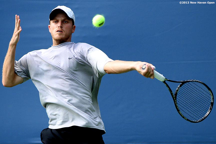 """Jeff Dadamo hits a forehand during a US Open National Playoff match on Day 2 of the New Haven Open at Yale University in New Haven, Connecticut Saturday, August 17, 2013."""