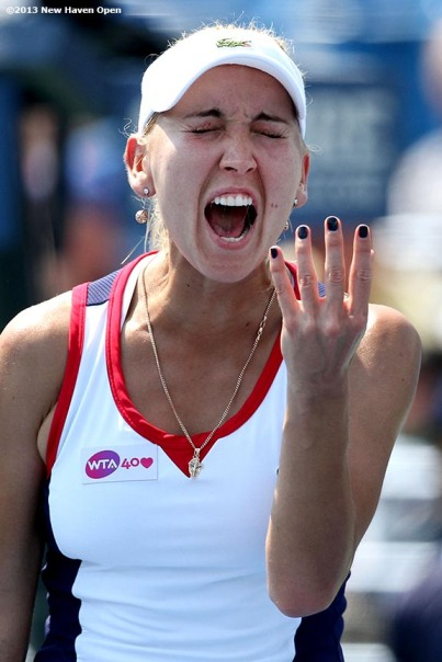 """""""Elena Vesnina reacts after losing a point on Day 5 of the New Haven Open at Yale University in New Haven, Connecticut Tuesday, August 20, 2013."""""""