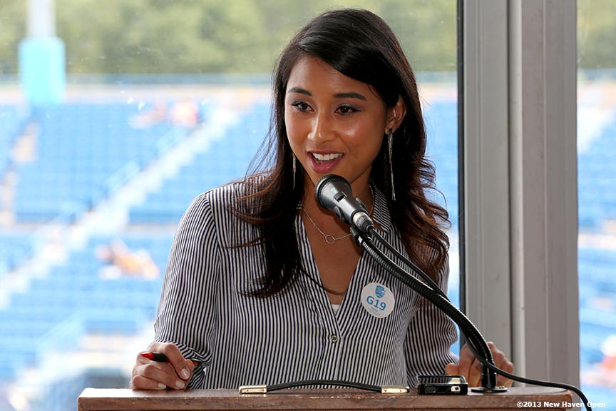 """""""ESPN anchor Prim Siripipat speaks to guests on Day 4 of the New Haven Open at Yale University in New Haven, Connecticut Monday, August 19, 2013."""""""